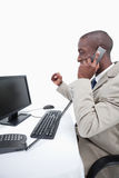 Portrait of a cheerful businessman making a phone call Stock Image