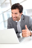 Portrait of cheerful businessman working on laptop Stock Photography
