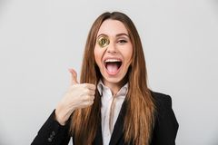 Portrait of a cheerful businesswoman dressed in suit Royalty Free Stock Photo