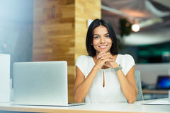 Portrait of a cheerful businesswoman in office Stock Image