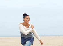 Portrait of a cheerful carefree young woman walking on the beach Royalty Free Stock Images