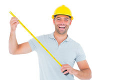 Portrait of cheerful carpenter holding tape measure Royalty Free Stock Image