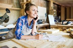 Portrait of Cheerful Carpenter with Smartphone stock images