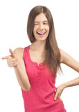 Portrait of cheerful casual girl pointing Stock Photography