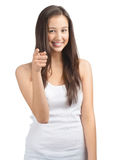 Portrait of cheerful casual girl pointing Royalty Free Stock Image