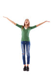 Portrait of a cheerful Caucasian teenager with hands raised poin Stock Photography
