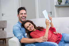 Portrait of cheerful couple with digital tablet Stock Photos