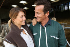 Portrait of cheerful couple of farmers Stock Image