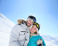 Portrait of a cheerful couple heading down the slopes Stock Images