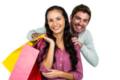 Portrait of cheerful couple holding colorful shopping bags Royalty Free Stock Photography
