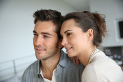 Portrait of cheerful couple at home Stock Images