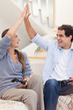 Portrait of a cheerful couple playing video games Royalty Free Stock Photos
