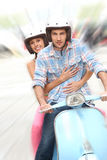 Portrait of cheerful couple riding the moto. Cheerful couple riding blue moto stock images