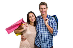 Portrait of cheerful couple with shopping bags Stock Photography