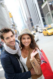 Portrait of cheerful couple shopping in nyc Royalty Free Stock Image