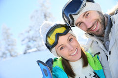 Portrait of cheerful couple on skiing holidays Stock Photos
