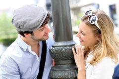 Portrait of cheerful couple standing by the street lamp Royalty Free Stock Images