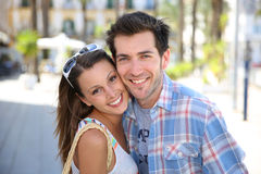 Portrait of cheerful couple in town Stock Images