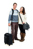 Portrait of cheerful couple in warm clothing with luggage Royalty Free Stock Photos