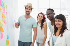 Portrait of cheerful coworkers standing together Stock Photos