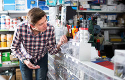 Portrait of cheerful customer in hardware store Stock Photos