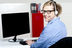 Portrait of cheerful customer support executive Stock Photo