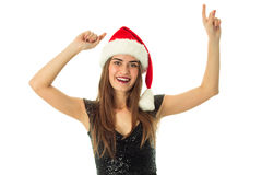 Portrait of cheerful cute woman in santa hat Royalty Free Stock Images