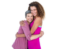 Portrait of cheerful daughter hugging mother Royalty Free Stock Images