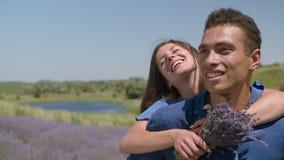 Portrait of multietnic couple rejoicing outdoors