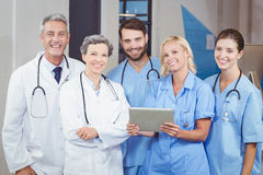 Portrait of cheerful doctor team with digital tablet Stock Image