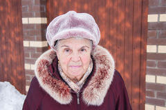 Portrait of the cheerful elderly woman in winter Royalty Free Stock Images