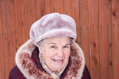 Portrait of the cheerful elderly woman in winter Stock Images