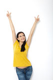 Portrait of cheerful European woman with hands raised pointing up Stock Image