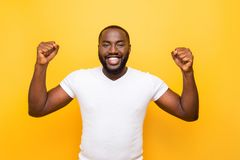 Portrait of cheerful excited delighted mulato man, showing winni royalty free stock photo