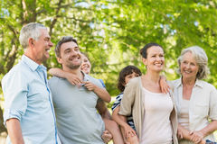 Portrait of cheerful extended family in park Royalty Free Stock Image