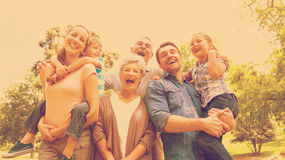 Portrait of cheerful extended family at park Stock Images