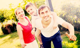 Portrait of cheerful family with boy sitting on father's back Royalty Free Stock Photos