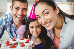 Portrait of cheerful family celebrating birthday at home Royalty Free Stock Images