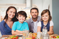 Portrait of cheerful family with food on dining table Royalty Free Stock Photo