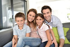 Portrait of cheerful family on sofa hanging out together Royalty Free Stock Image