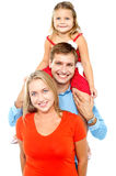 Portrait of cheerful family of three having fun Stock Photo
