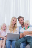 Portrait of a cheerful family using a laptop Royalty Free Stock Image