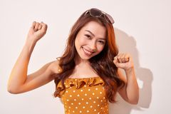 Portrait of cheerful fashion girl going crazy in a orange polka dots dress. Portrait of cheerful fashion girl going crazy in a orange polka dots dress royalty free stock photo