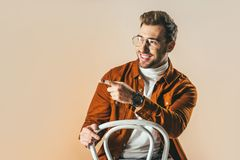 portrait of cheerful fashionable man pointing away stock photos