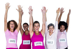 Portrait of cheerful female athletes with arms raised Stock Photography