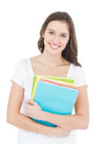 Portrait of cheerful female college student holding books Stock Image