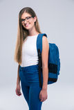 Portrait of a cheerful female teenager with backpack Royalty Free Stock Photography