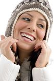 Portrait of cheerful female with woolen cap Royalty Free Stock Photography
