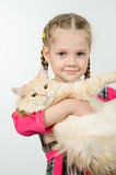 Portrait of cheerful four-year girl with a cat in her arms Stock Photo