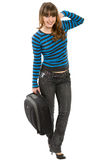 Portrait of the cheerful girl. The young girl in jeans and with a suitcase in hands royalty free stock photo